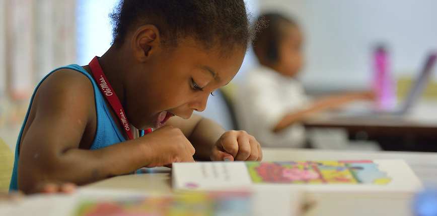 A Horizons student practices academic skills during the summer program.