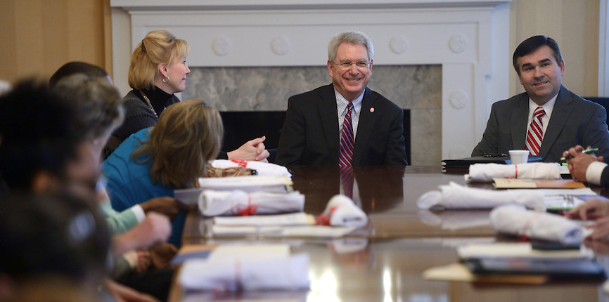 Chancellor Dan Jones and Albert Nylander speak at the Mississippi Commission for Volunteer Service meeting.