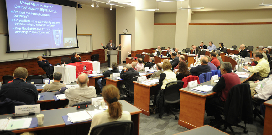 Legal professionals and law enforcement officials attend a Fourth Amendment Conference.