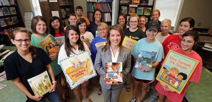 Early Literacy Instruction students are photographed with some of their favorite children's titles.
