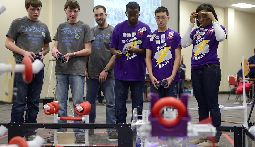 An obstacle course challenges the maneuvering capabilities of the students' robotic designs.