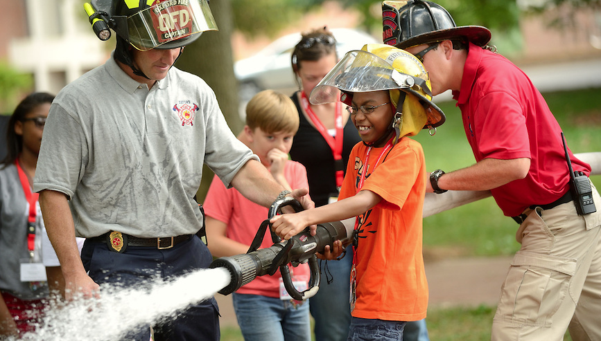 The Oxford fire department helps Math Camp attendees learn about real world math applications.