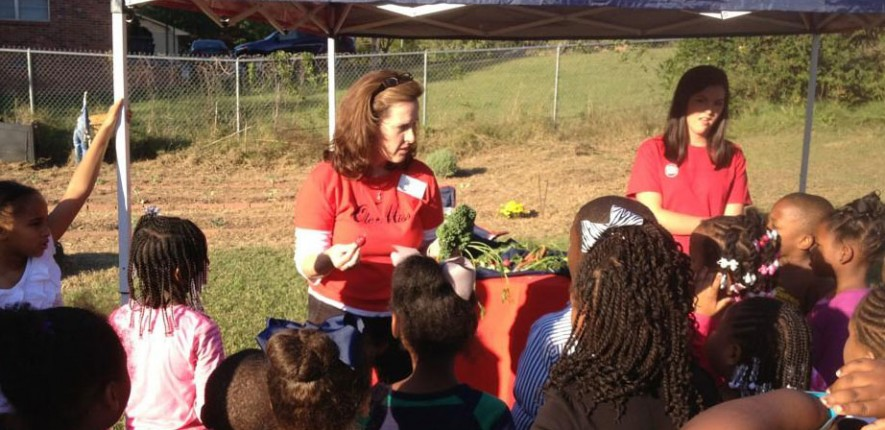 Janie Cole helps create a school garden.