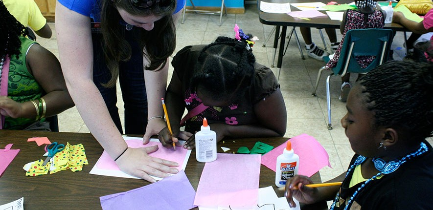 A student completes a Traveling Trunk activity.
