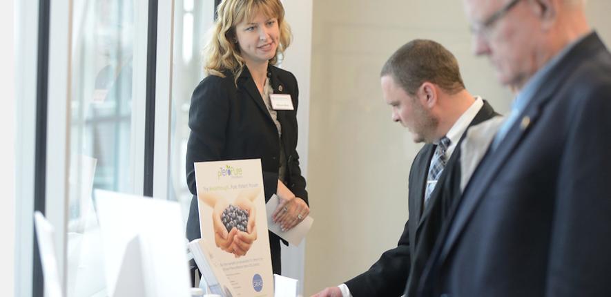 Allyson Best, Associate Director of Technology Management, exhibits pTeroPure.