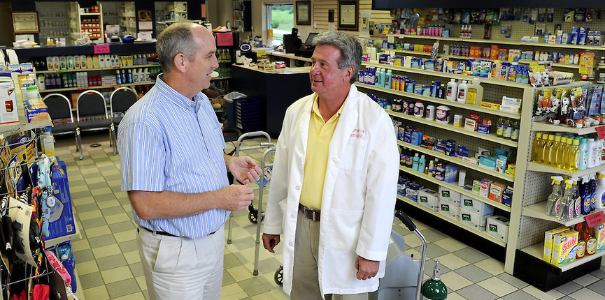 Ben Banahan meets with Bob Lomenick, owner of Tyson Pharmacy in Holly Springs, MS.