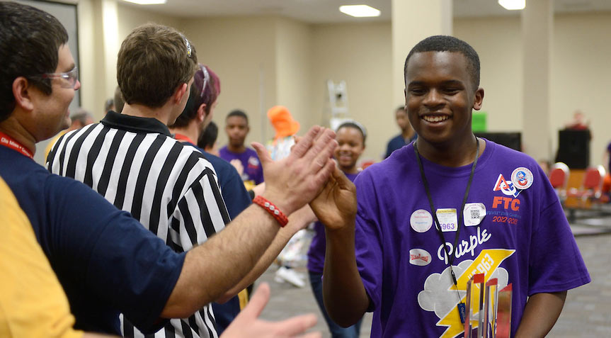 Teams congratulate each other at the FIRST Tech Challenge.